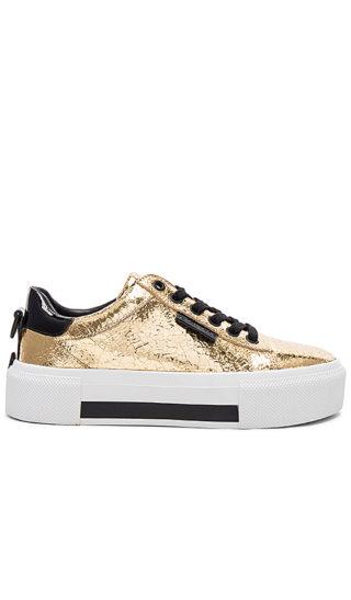 KENDALL + KYLIE Tyler Sneaker in Metallic Gold